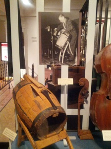 This barrel cello is included in the Graese Gallery's section on American instrument making.  Nearby are exhibits of Civil War instruments, and a case of fantastic mandolins (including one shaped like an airplane).