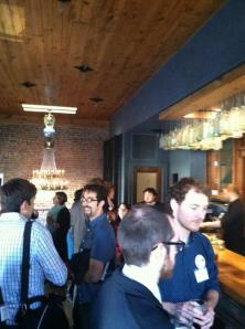 Conference attendees enjoying the happy hour at Revolution House